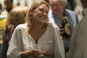 A MEMBER ENJOYING HER MEMBERSHIP BENEFITS AT A RECEPTION