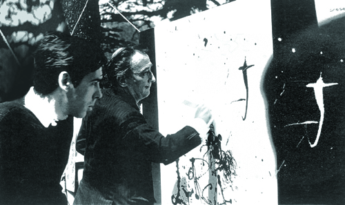 Dalí painting the inside illustration of the album